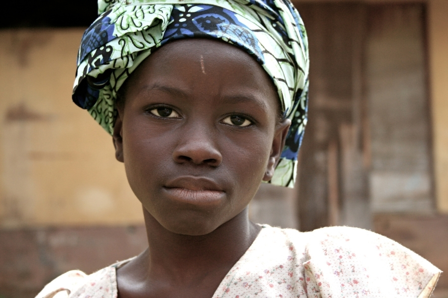 Young black african girl looking sad